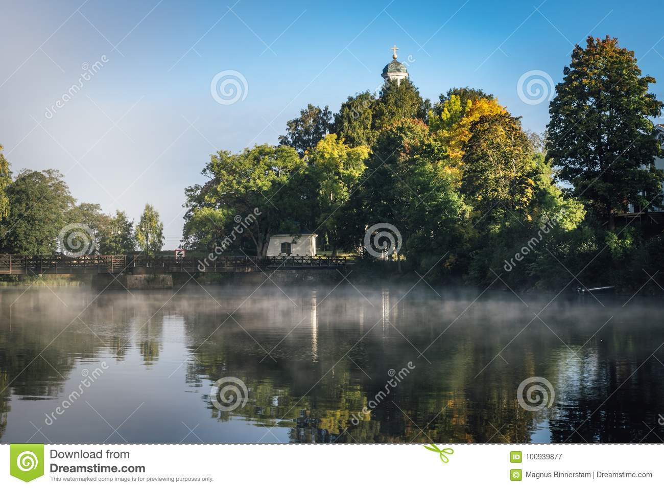 Early morning with mist and autumn colored trees