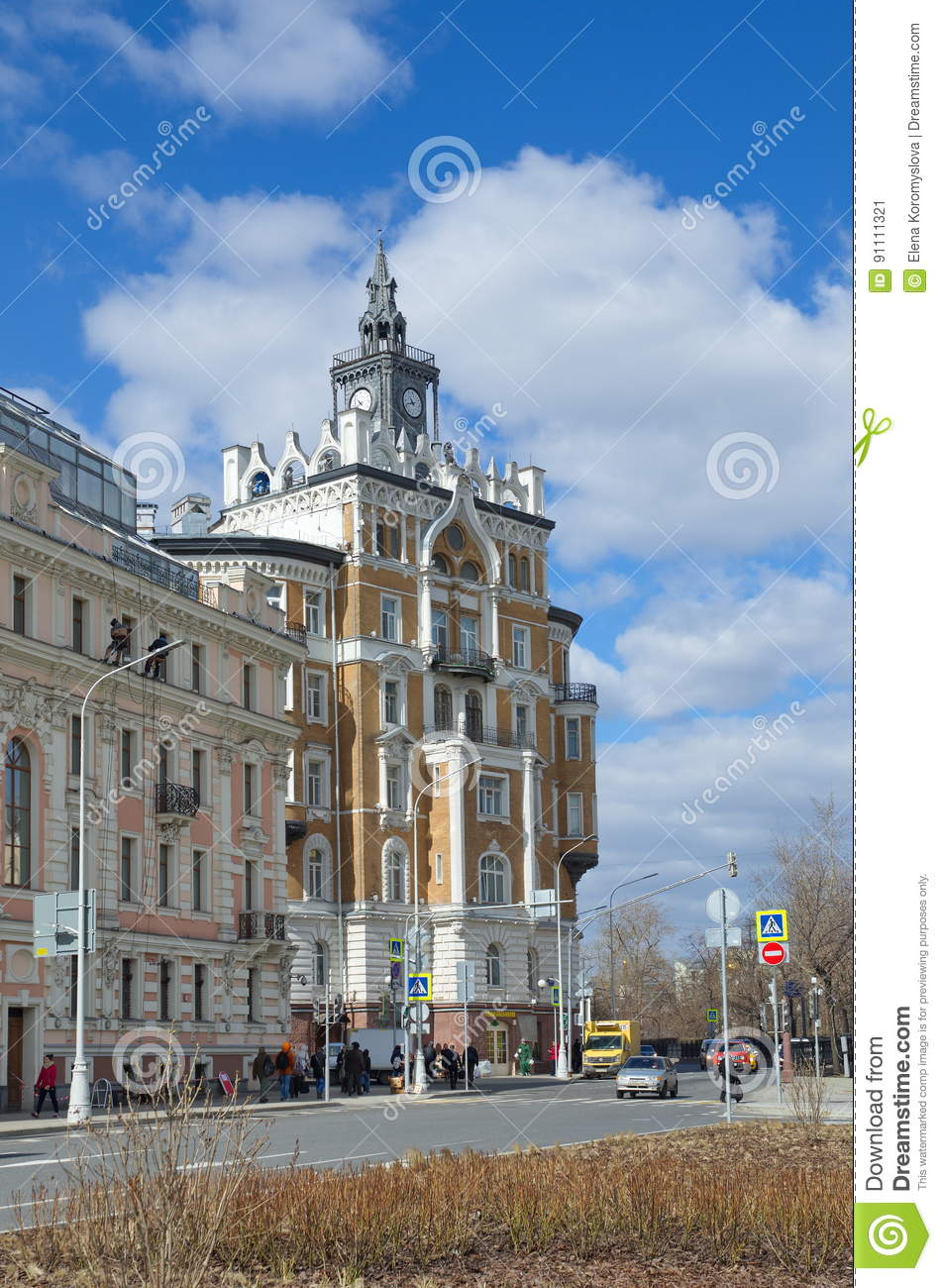 Beautiful vintage house with a clock in moscow russia editorial photo