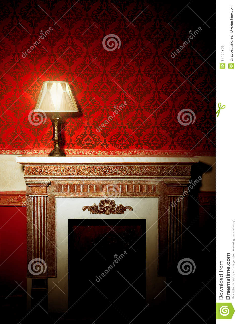 beautiful vintage interior with lamp on fireplace stock photo