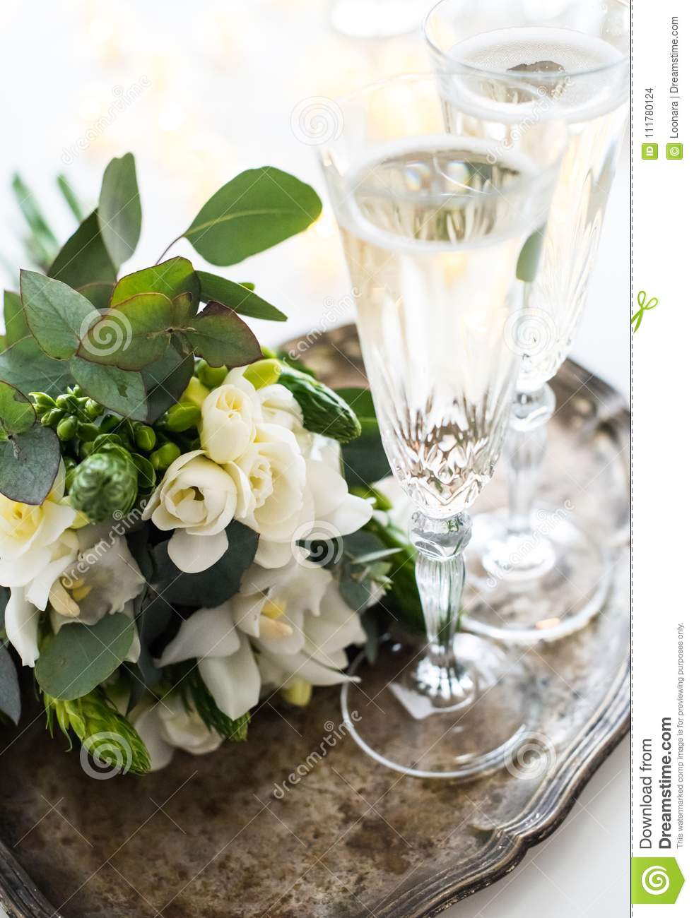 Beautiful vintage wedding decoration with champagne and white fl