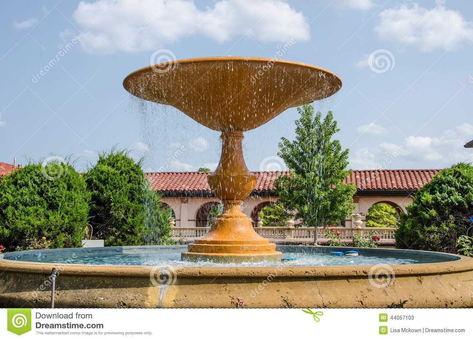 Beautiful Water Fountain In A Flower Garden Stock Photo