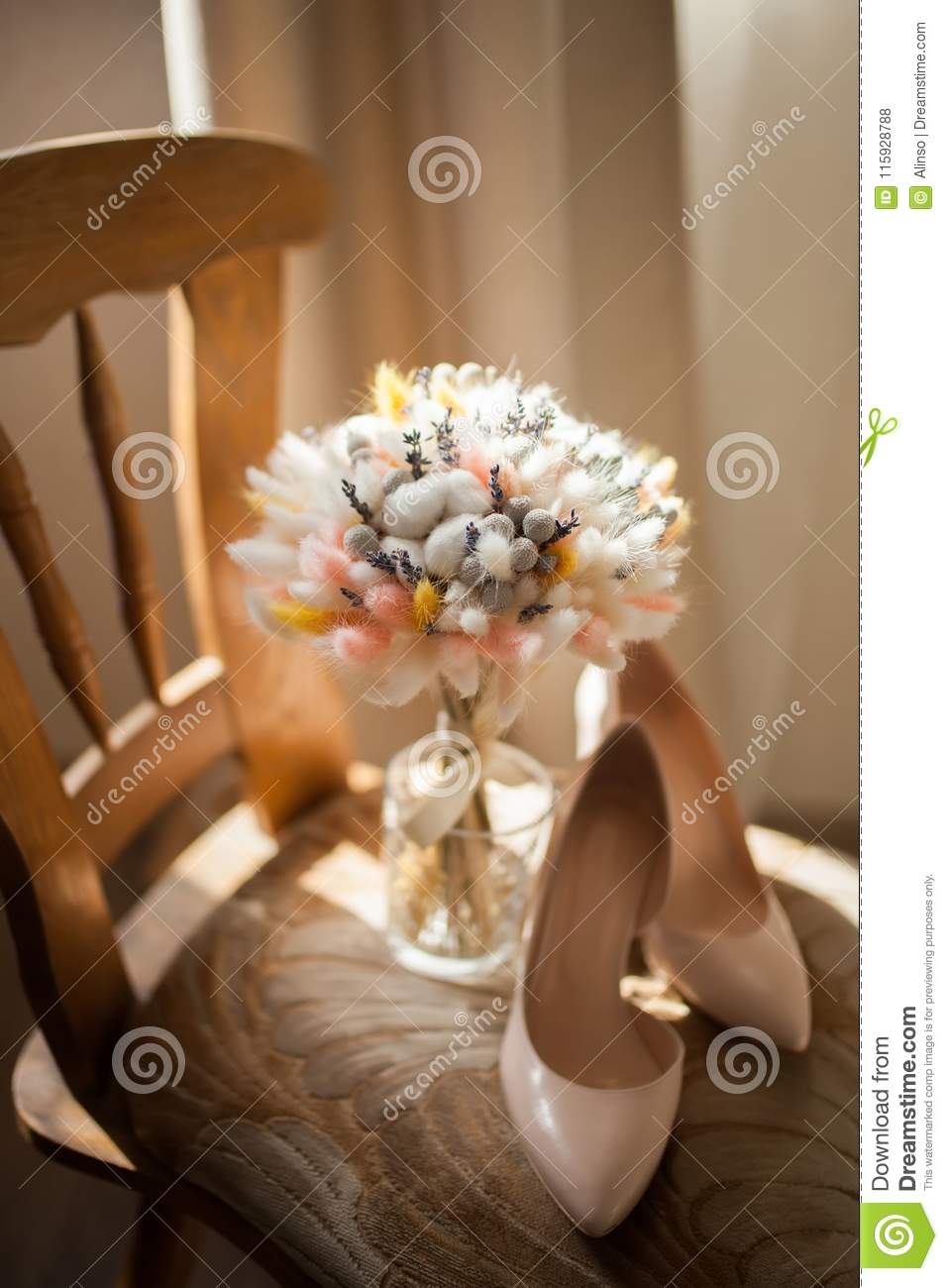 Beautiful Wedding Bouquet Of Dry Flowers And Brides Shoes Stock