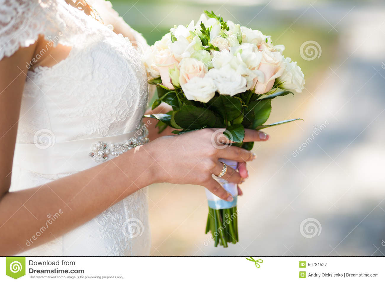 Beautiful Wedding Bouquet Of Flowers In Hands Of Young Bride Stock Photo Image 50781527