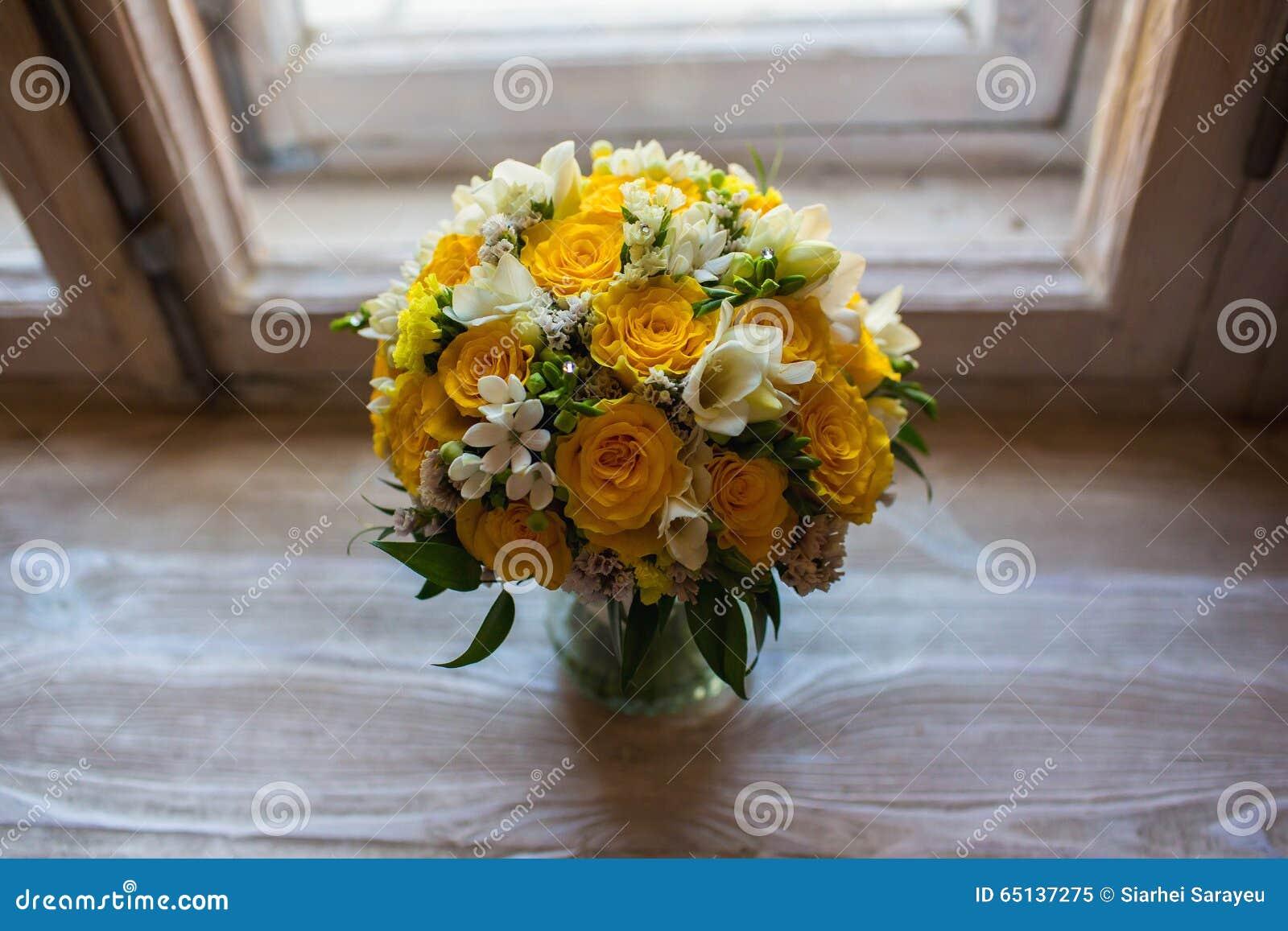 Beautiful wedding bouquet on windowsill background