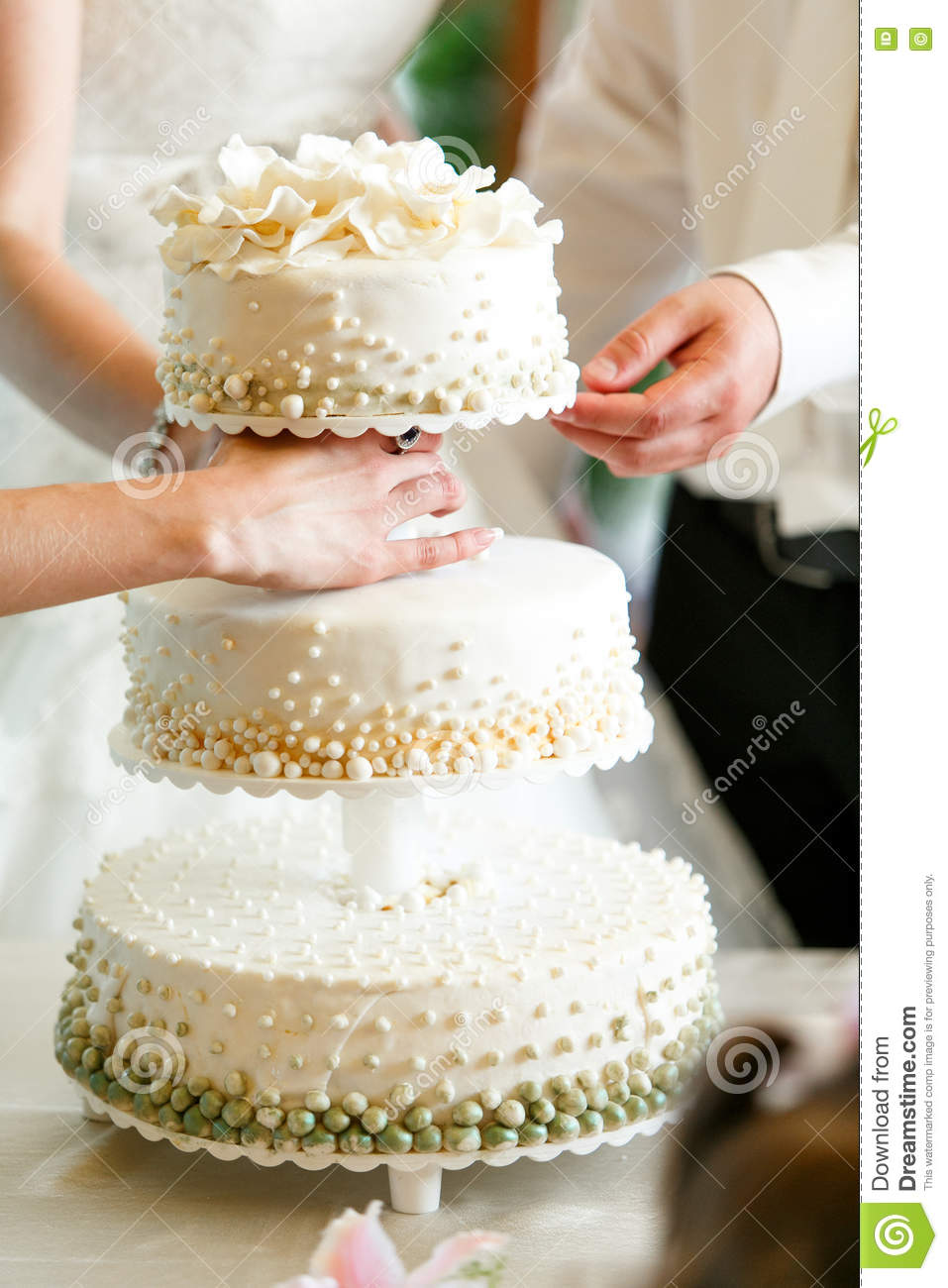 A Beautiful Wedding Cake Decorated With Green And White Pearls Stock ...