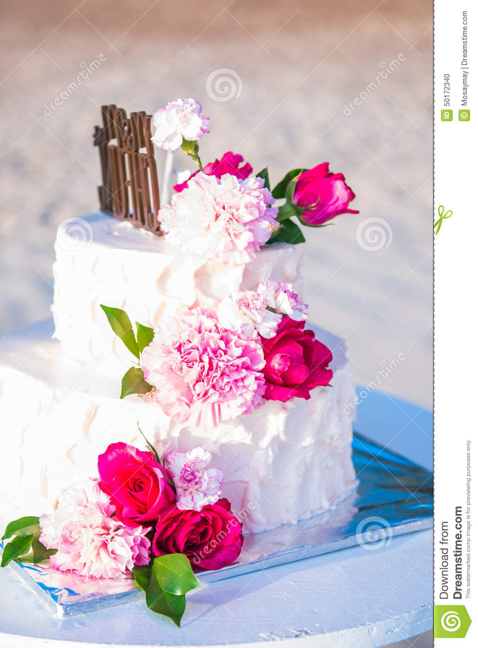 beautiful wedding cake with flower stock photo