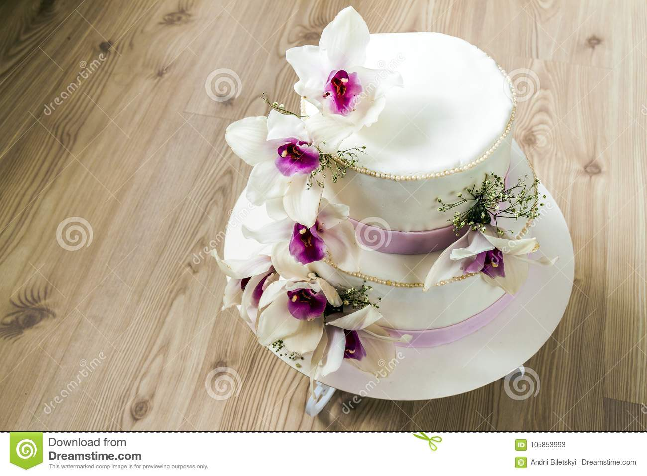 Beautiful Wedding Cake With Flowers Close Up Of Cake With Blurr