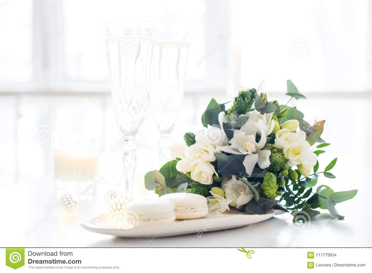 Beautiful wedding decoration with champagne and flowers, elegant