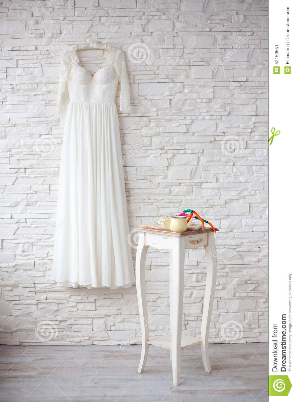 Beautiful wedding dress on hanger white brick wall stock for Wedding dress hanger amazon