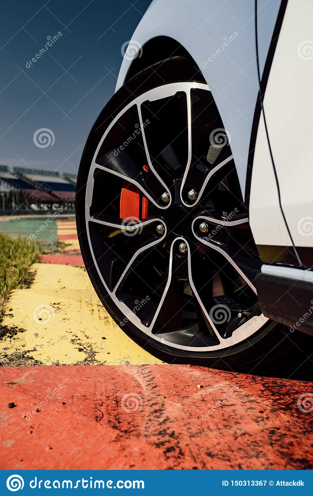 The beautiful wheel of a sport car, with the asphalt, in a race track. sport car on track