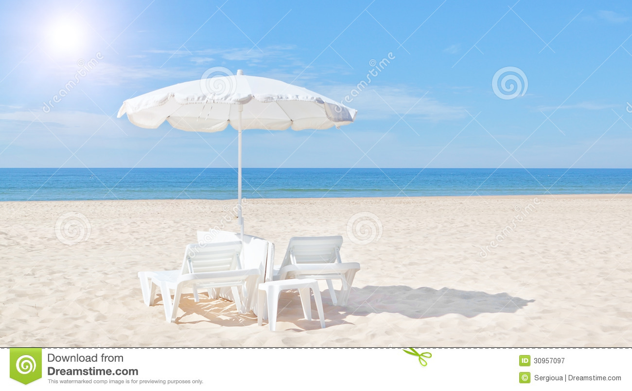 Beautiful White Beach Umbrella And Sun Bed On The Beach ...