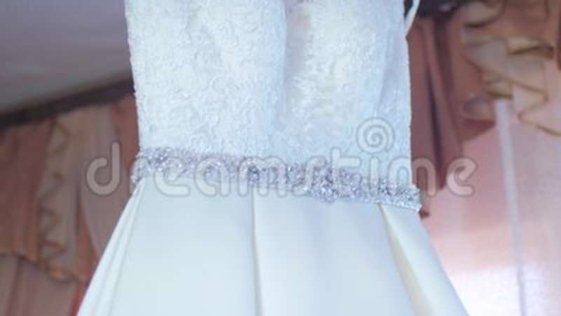 Beautiful White Dress Hanging On A Hanger Stock Footage - Video of ...