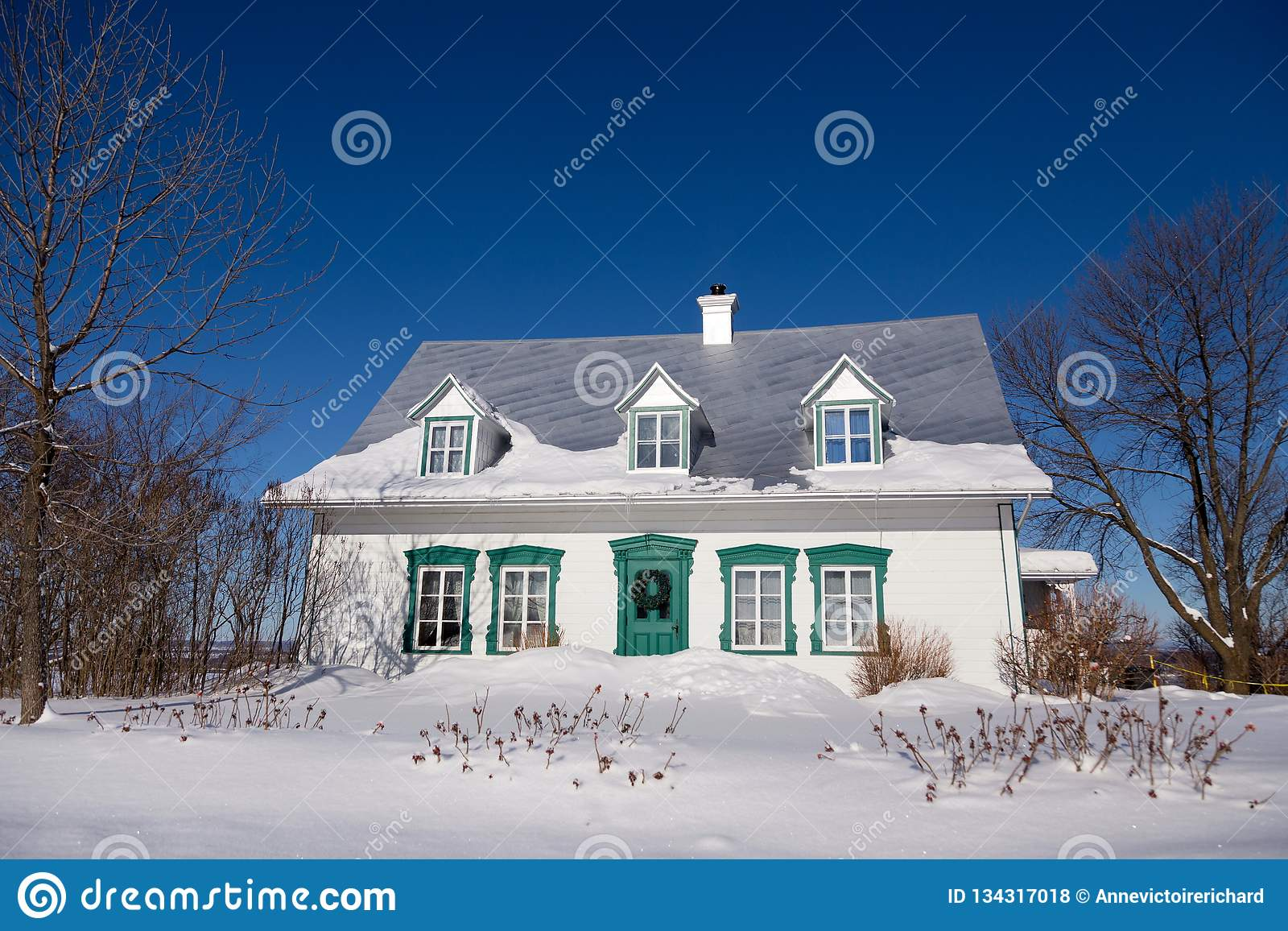 Beautiful White French Style Ancestral House With Green Trimmed Windows And Door Stock Photo Image Of Quebec Gable 134317018