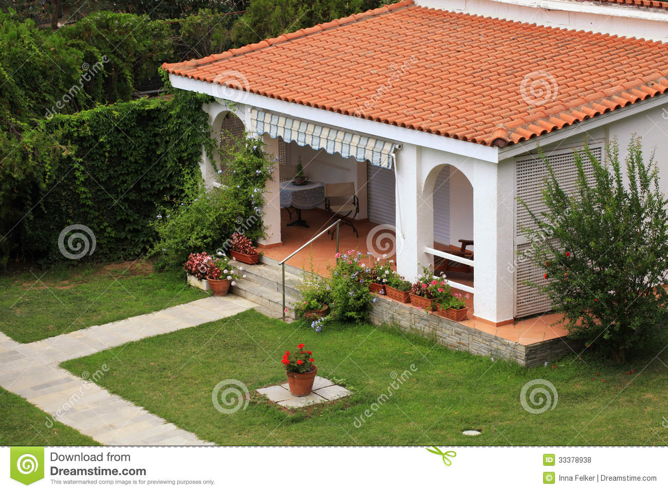 Beautiful White House With Small Terrace In The Garden.