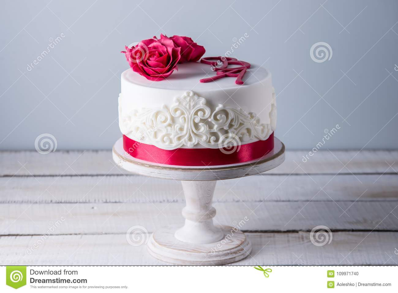 Beautiful White Wedding Cake Decorated With Flowers Red Roses And