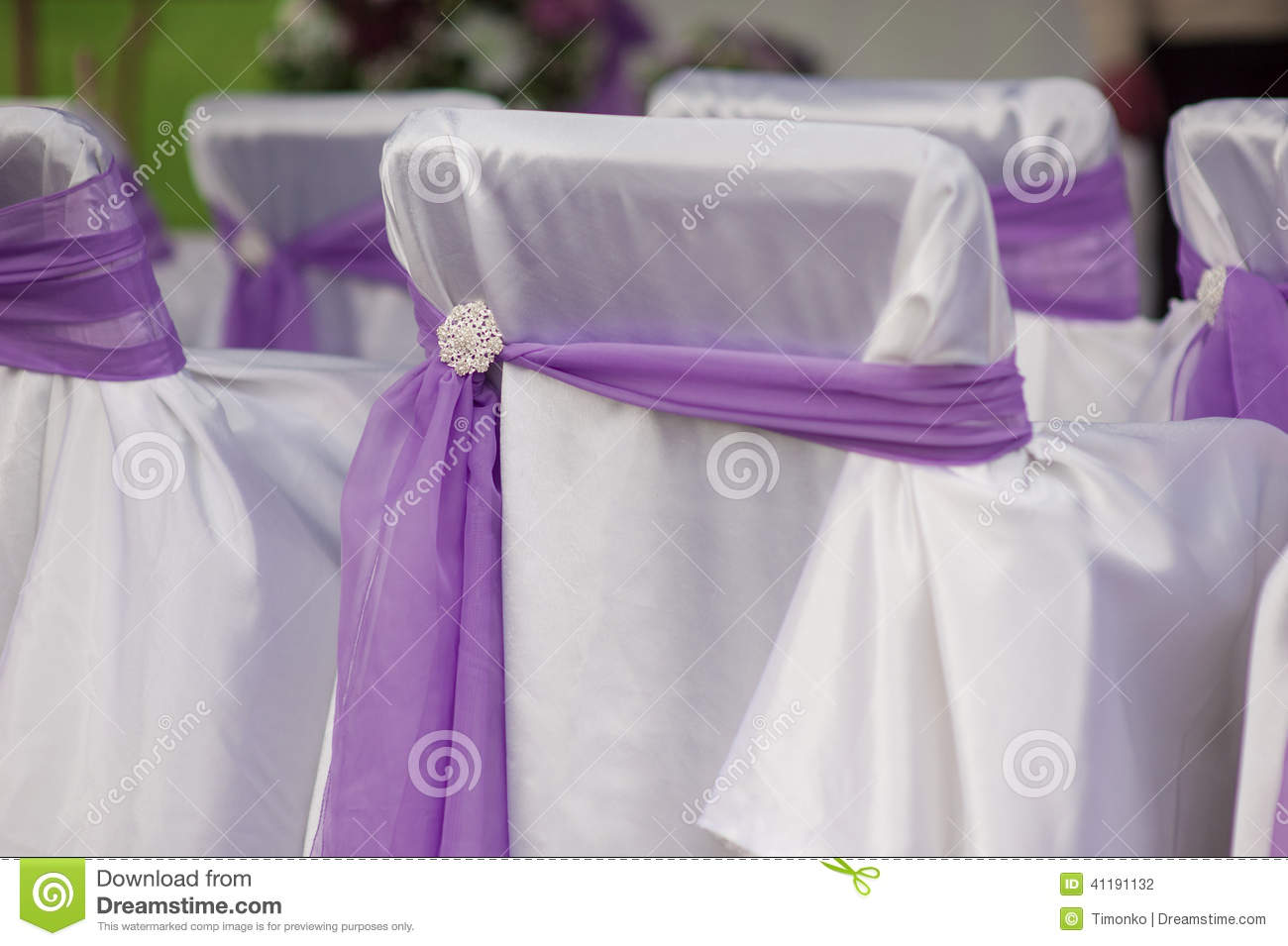 White Chairs At A Wedding Indoor Stock Photo: Beautiful White Wedding Chairs Decorated With Purple Bows