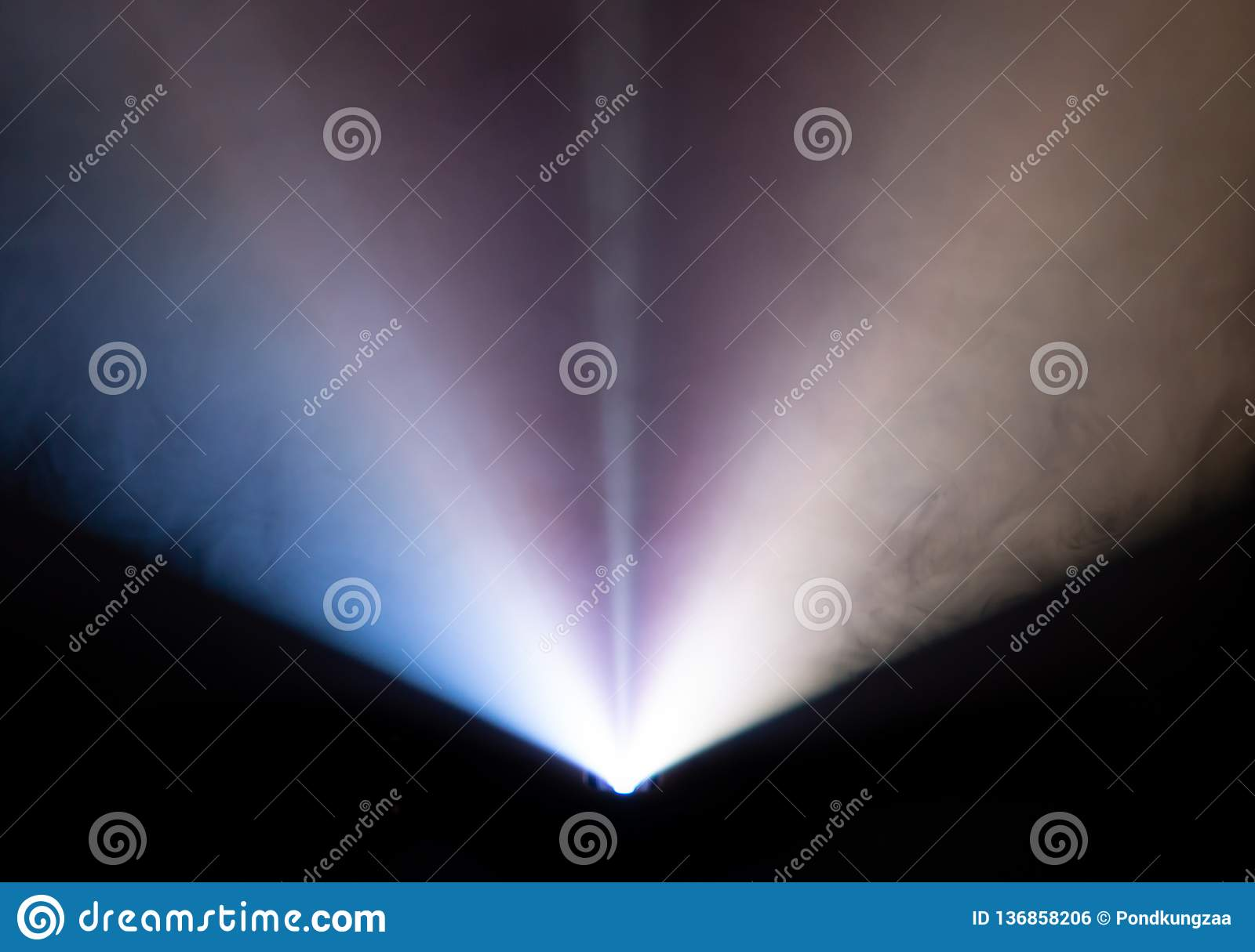 Beautiful wide lens projector with light beam for movie and cinema at night . smoke texture spotlight . screening for multimedia