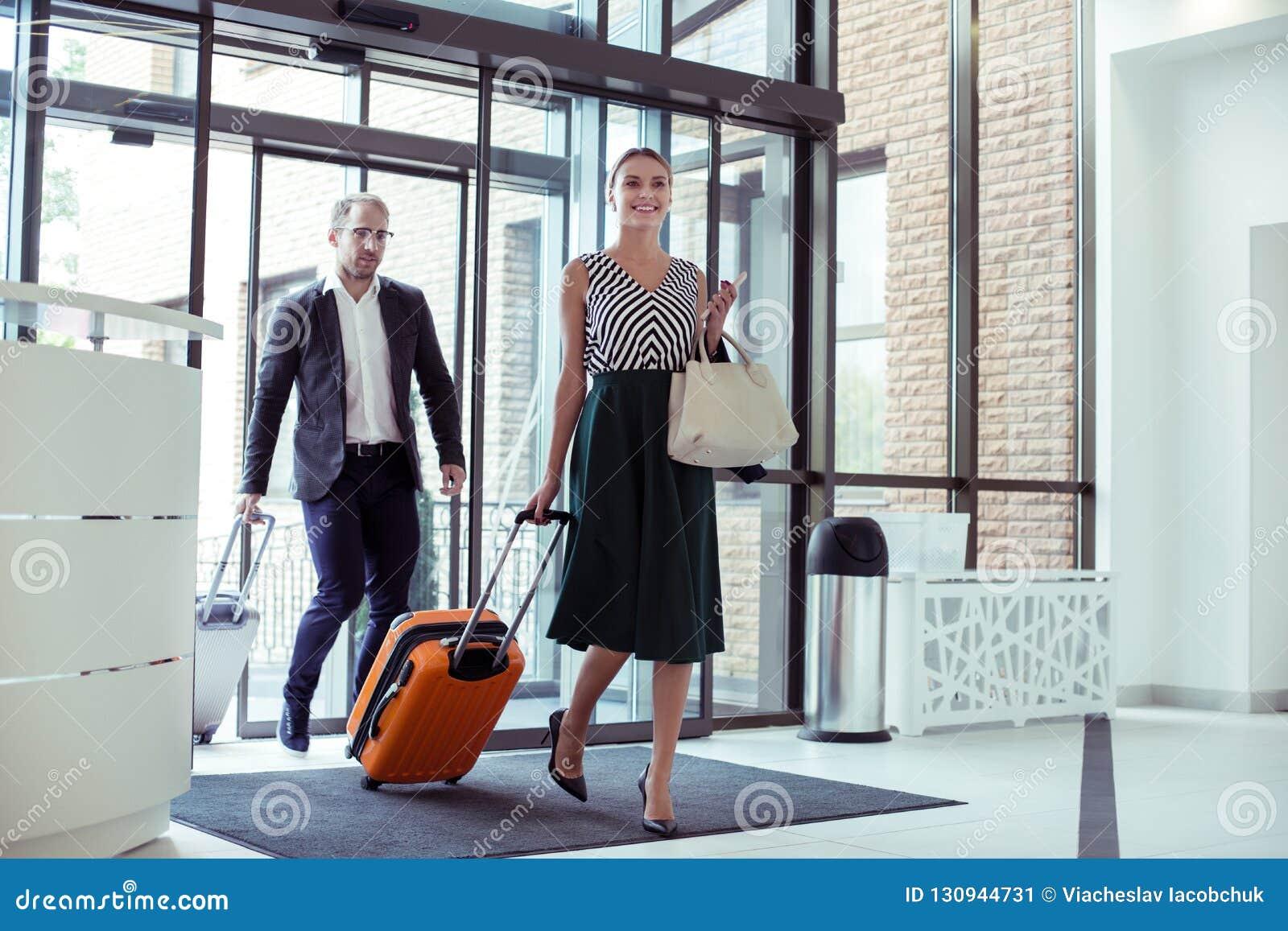 Beautiful wife accompanying her successful husband on business trip