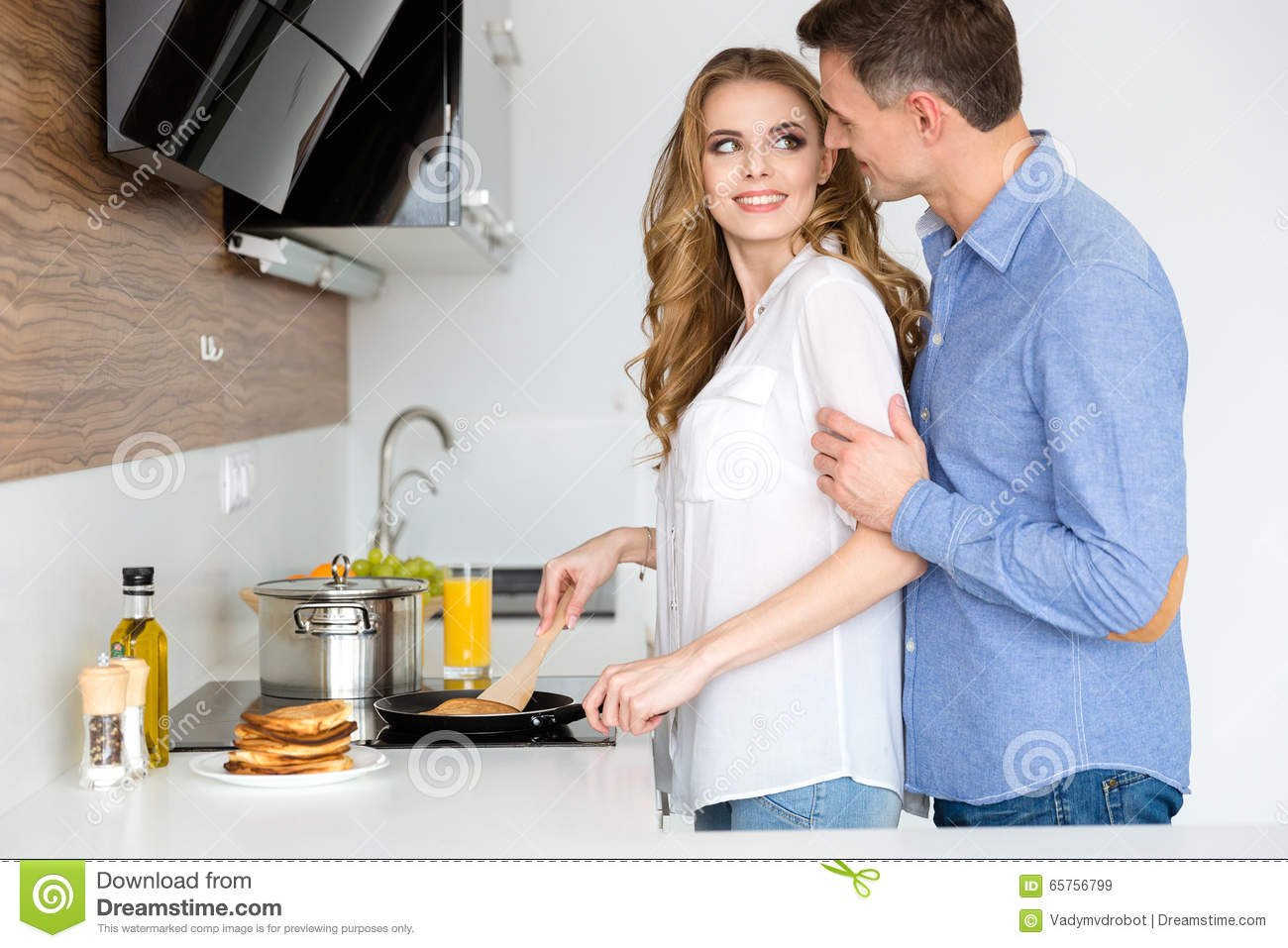 Beautiful Wife Making Pancakes And Flirting With Husband Stock Image ...