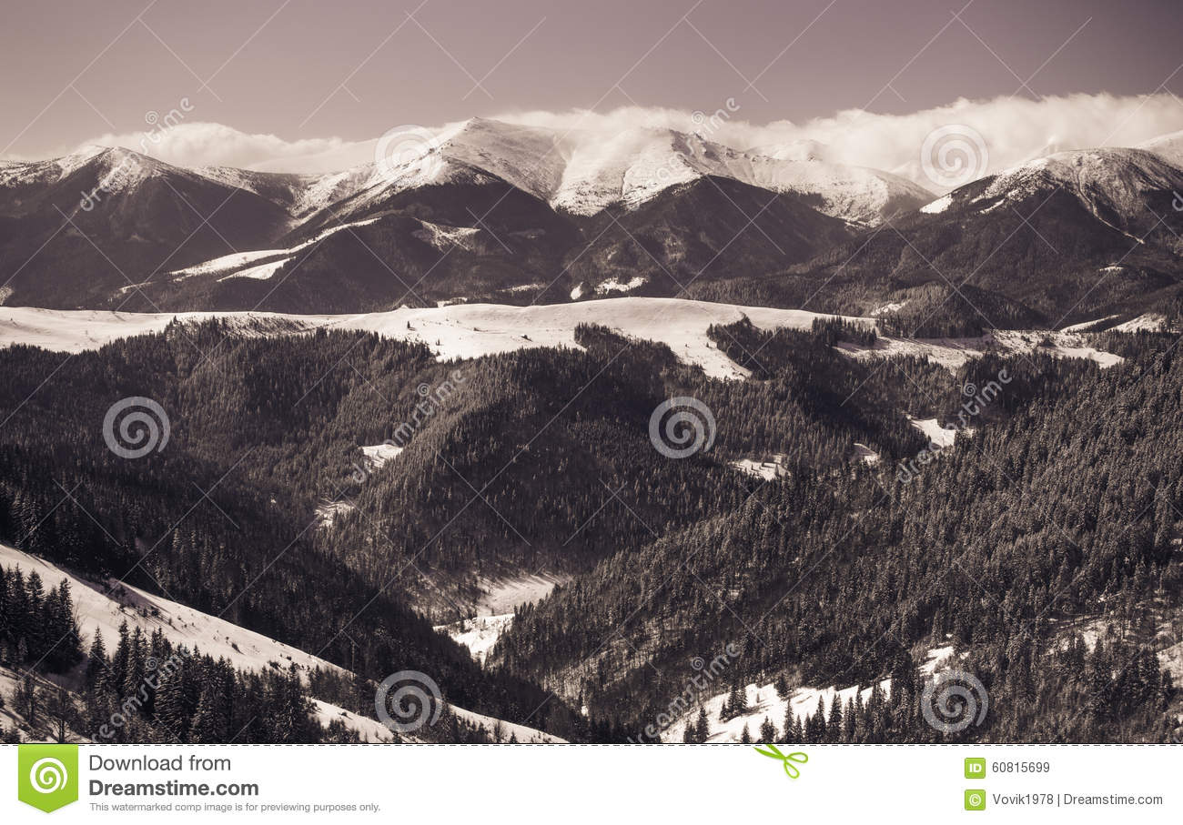 Beautiful winter landscape with snow covered mountains.