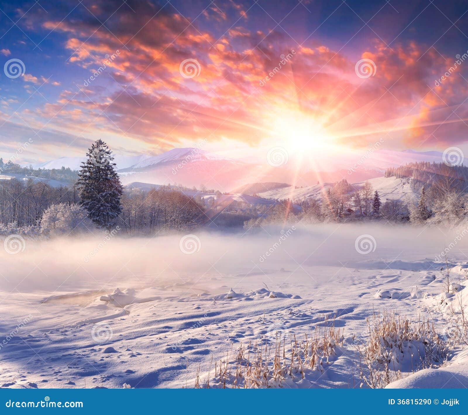 Beautiful winter sunrise in mountain village.
