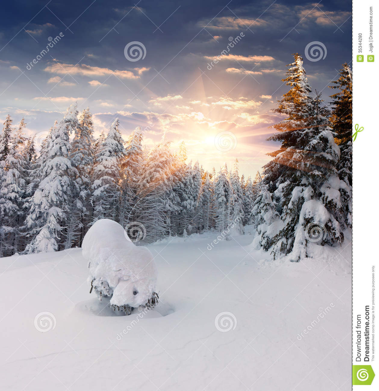 Beautiful Winter Sunrise In Mountains Stock Photo