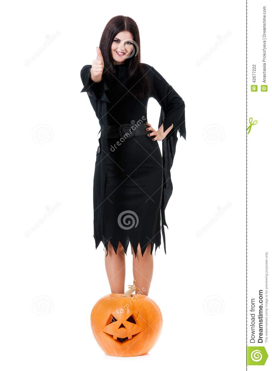 ... young witch with halloween gourd isolated on white background