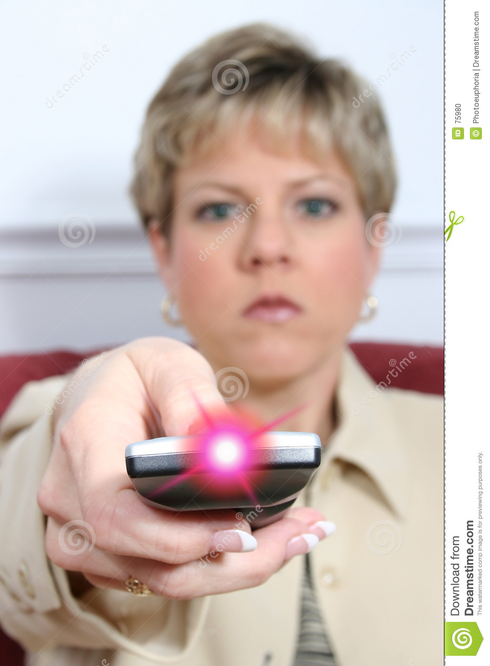 Beautiful Woman Aiming Remote with Light On