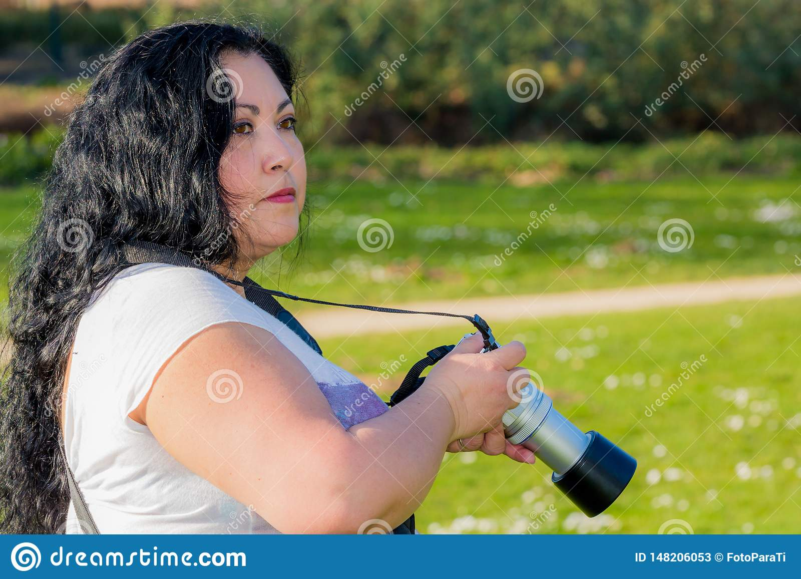 Beautiful woman analyzing the place to see where she will take her next picture