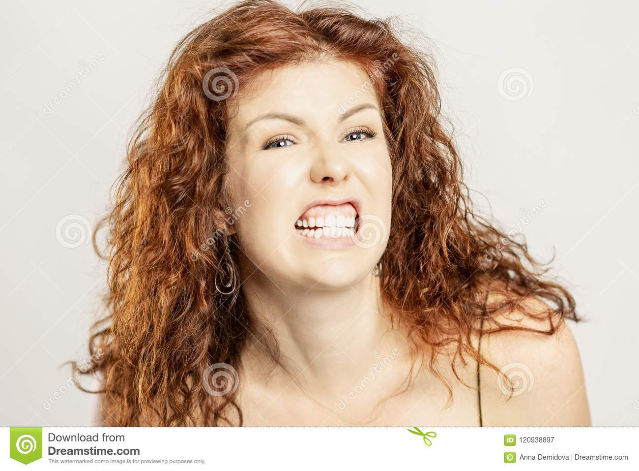 A beautiful woman is angry with an angry grin