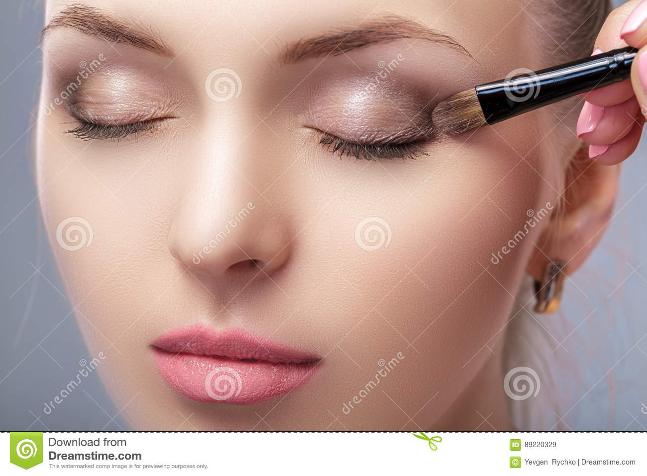 Beautiful Woman Applying Brown Eye Shadow Using Makeup Brush Makeup