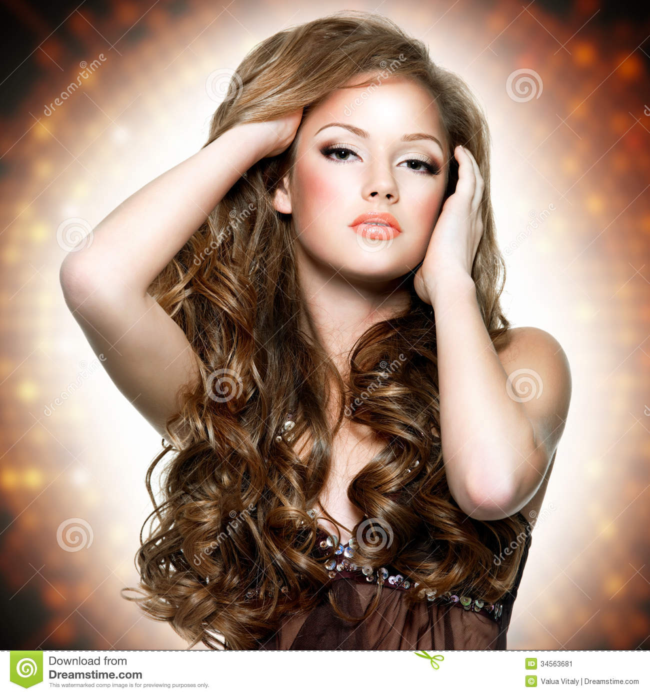 Beautiful woman with attractive face and long curly hairs