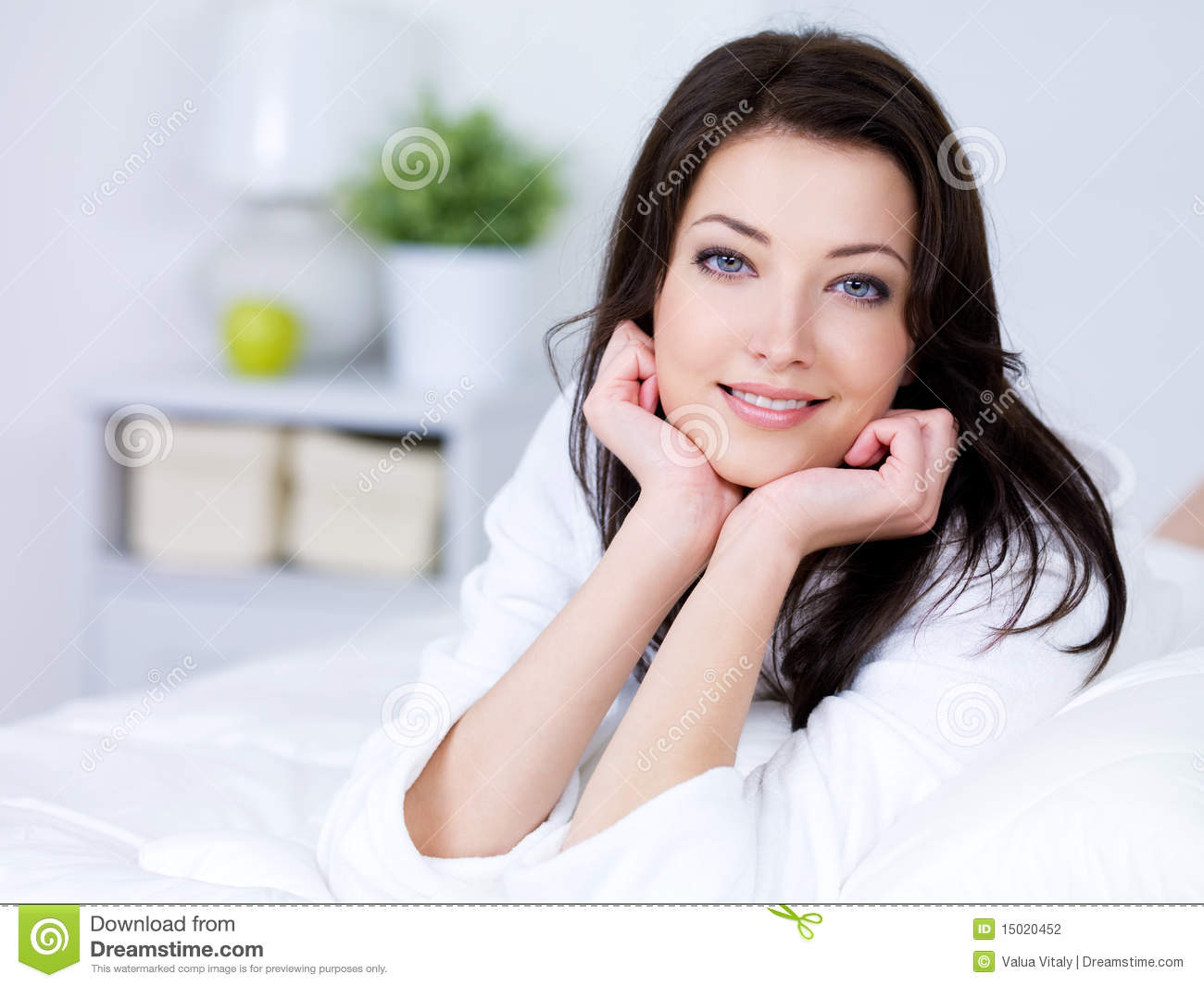 Beautiful woman with attractive smile at home