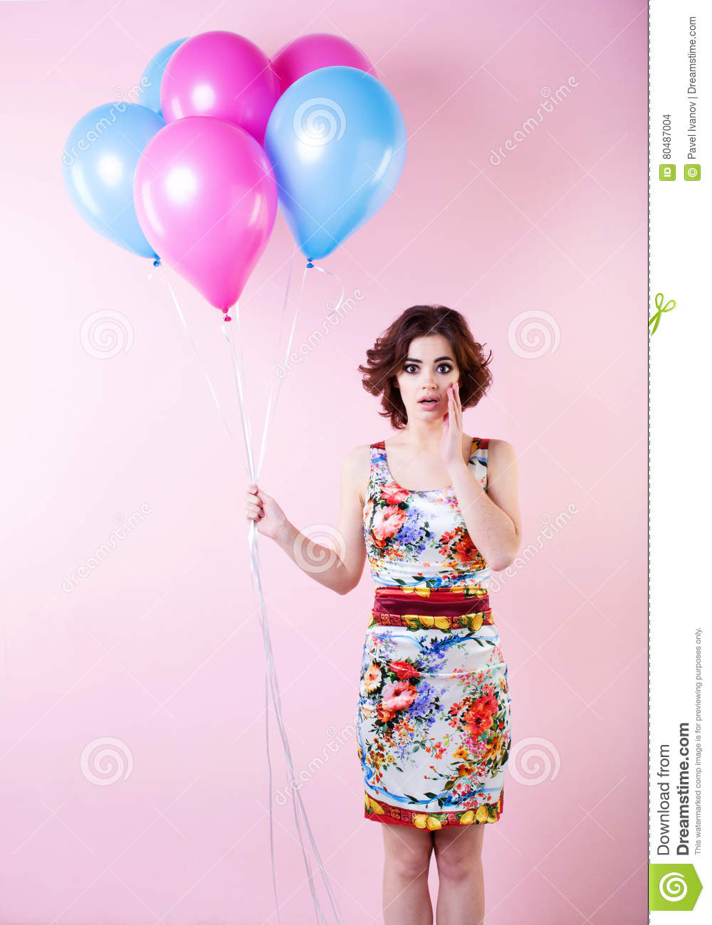 Beautiful woman with balloons. Concept Celebration and Party.