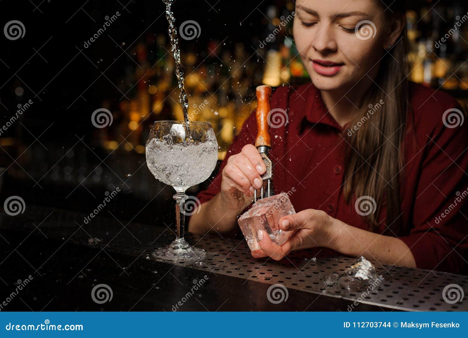 Beautiful Woman Barman Preparing An Ice Cube For Making An Aperol