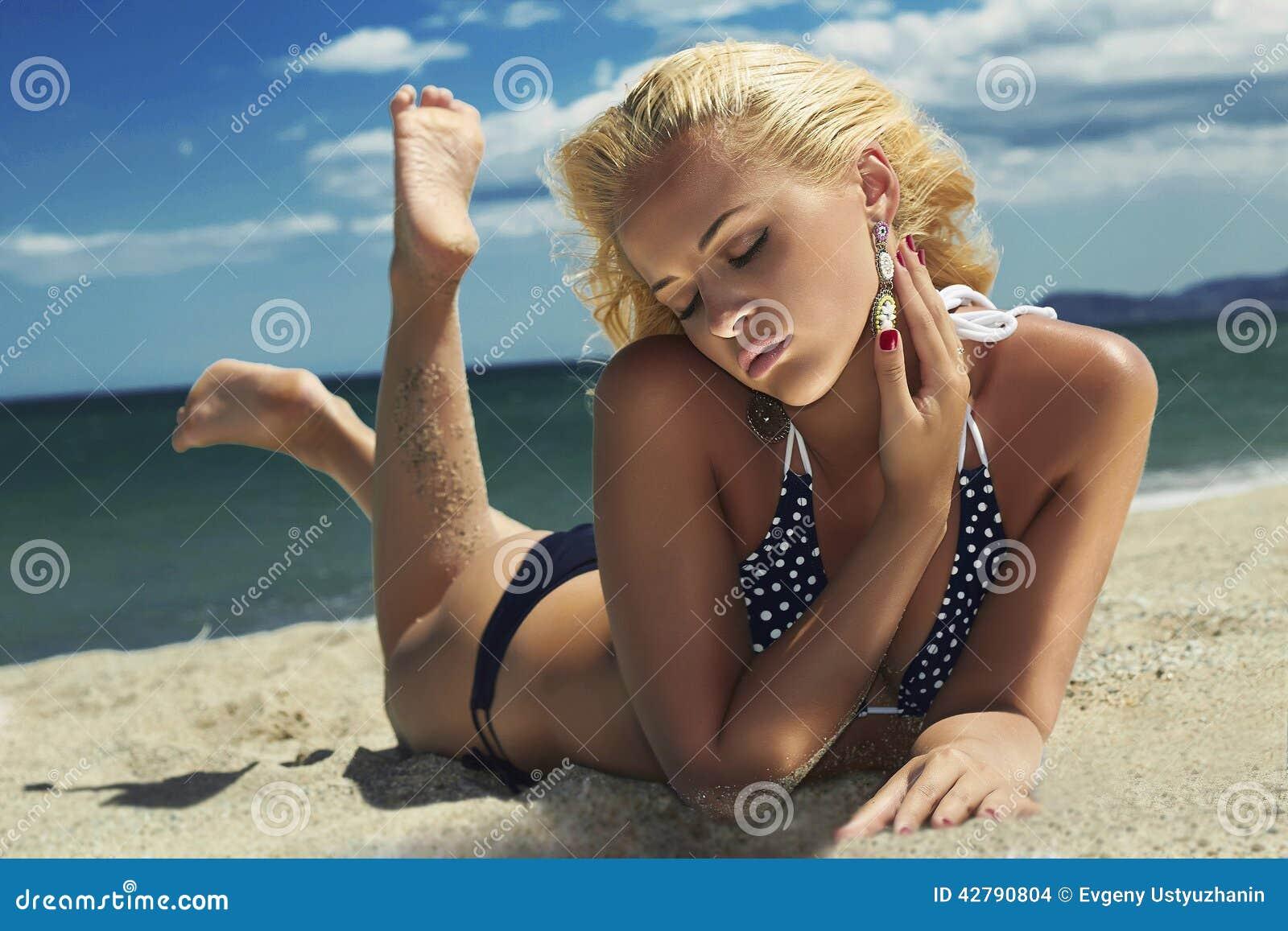 Beautiful woman on the beach. Blond girl in bikini. summer holidays