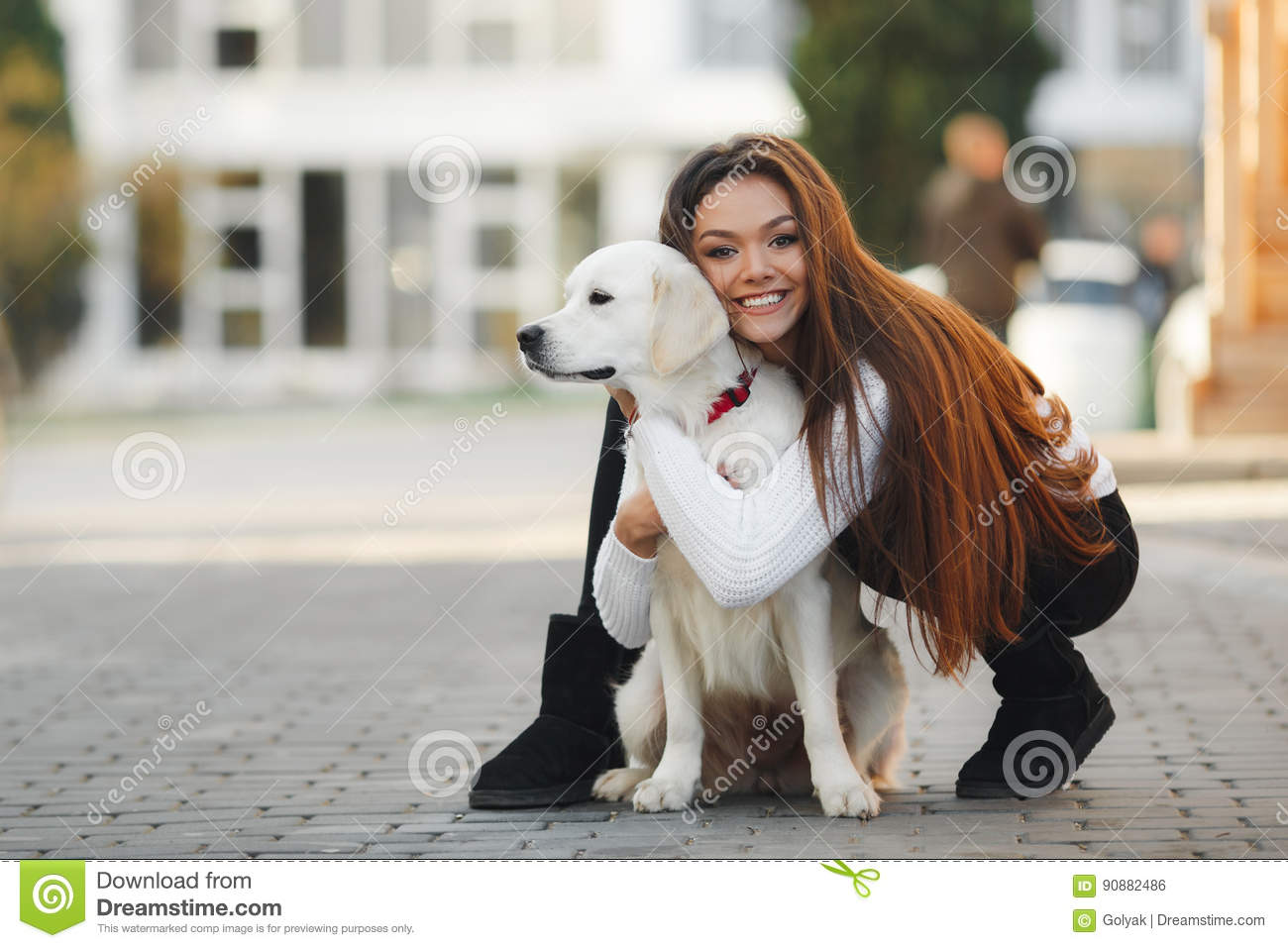 Beautiful woman with beloved dog outdoors