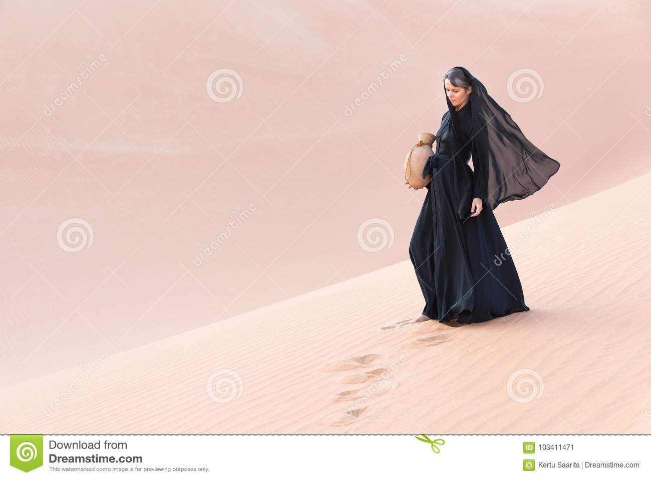 Woman In The Desert With A Traditional Arabic Clay Water Amphora