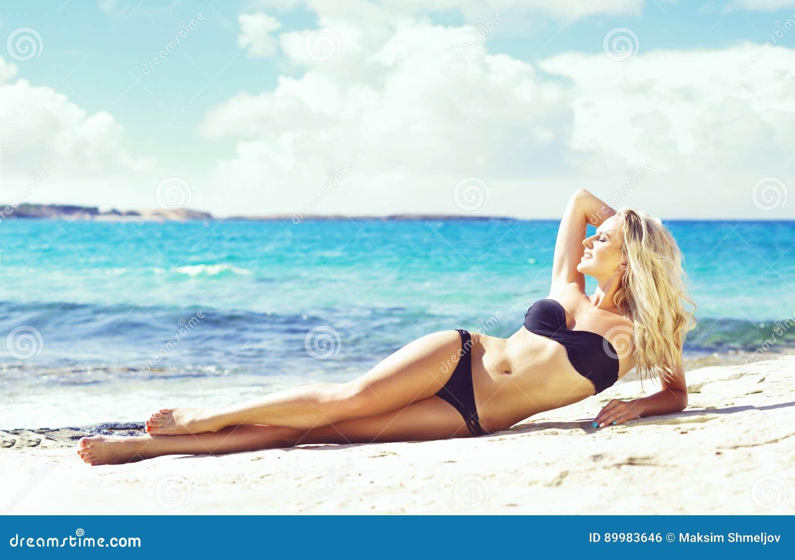 8a904b1e3e Beautiful Woman In Black Bikini. Young And Sporty Girl Posing On ...