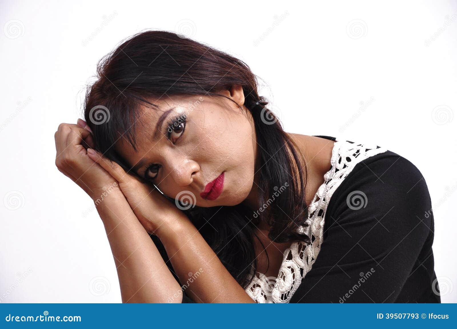 Beautiful woman black dress inclines her head