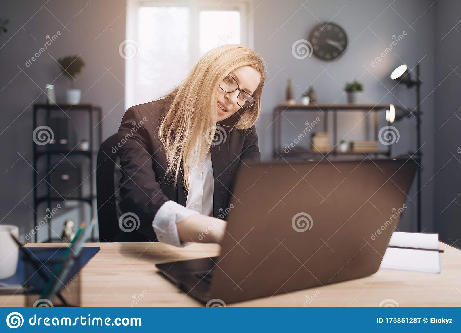 Woman Having Phone Conversation While Working On Laptop Stock Image Image Of Elegant Occupation 175851287