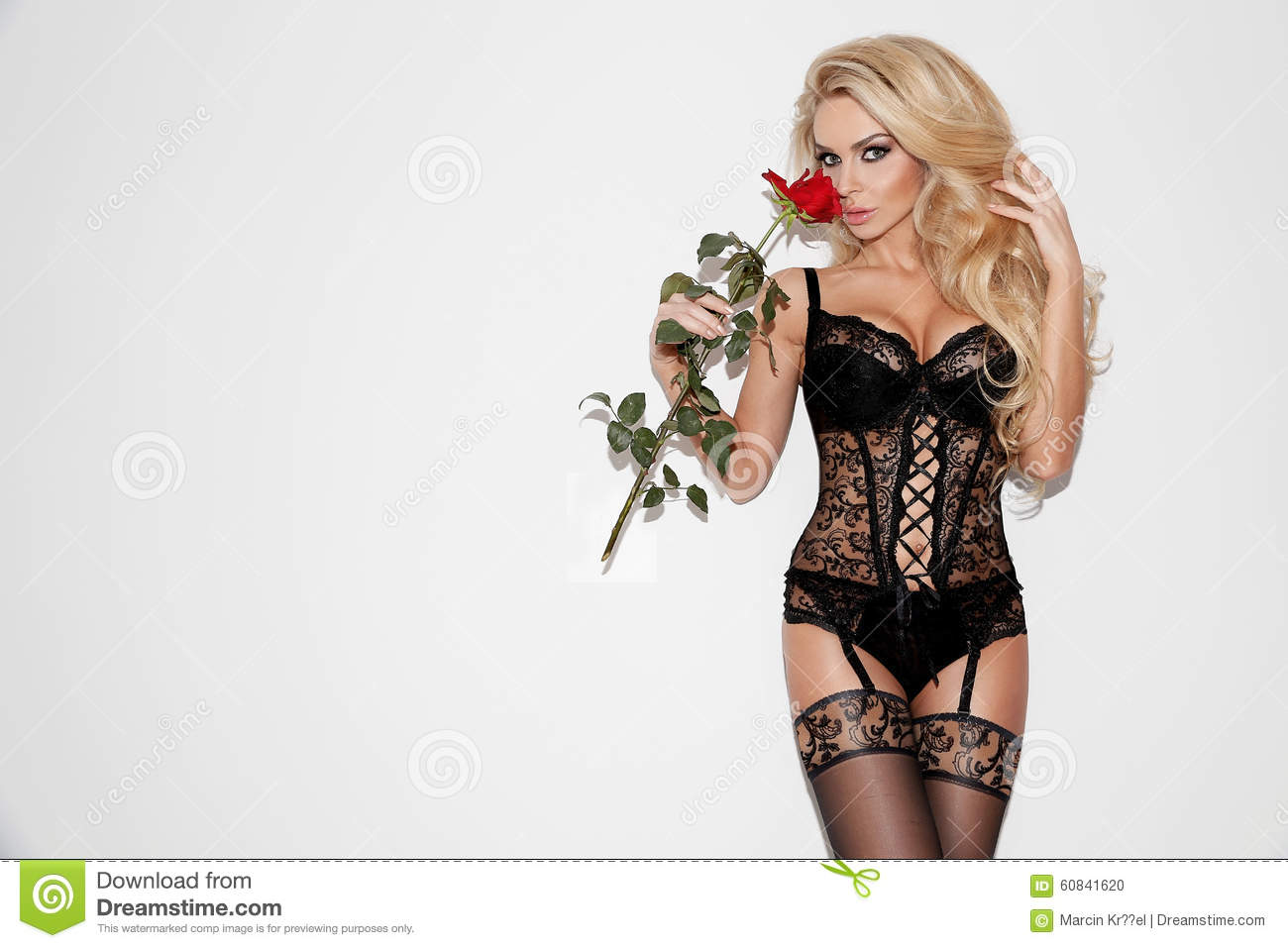 124697304fdd Beautiful woman blonde hair green eyes in black lingerie with the red rose  in hand