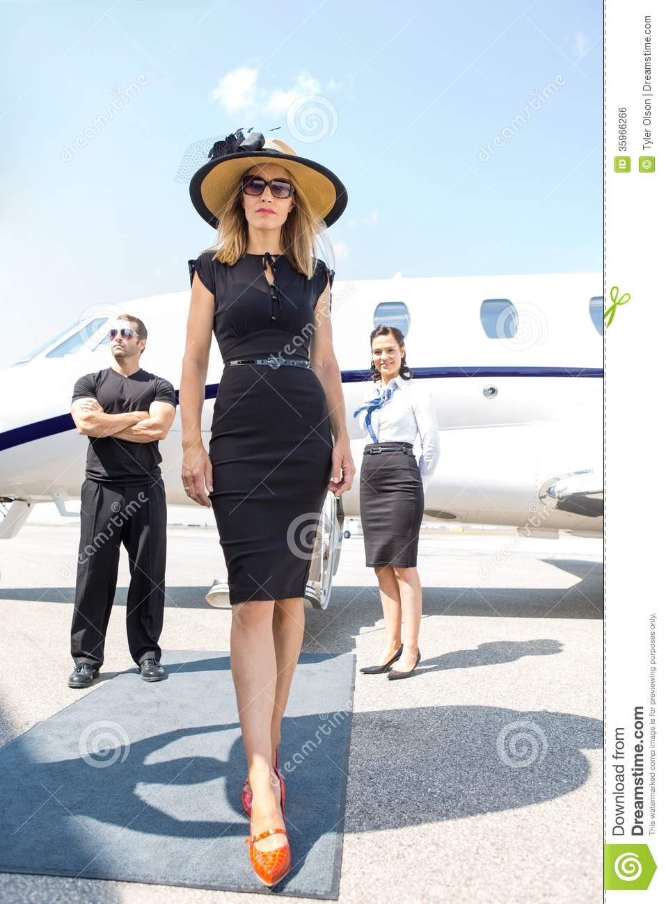 Beautiful Woman With Bodyguard And Airhostess Royalty Free