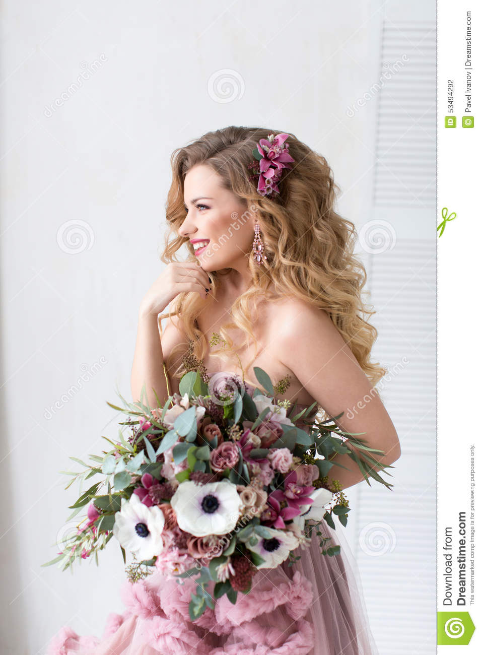 Beautiful Woman With A Bouquet Of Flowers In A Pink Dress