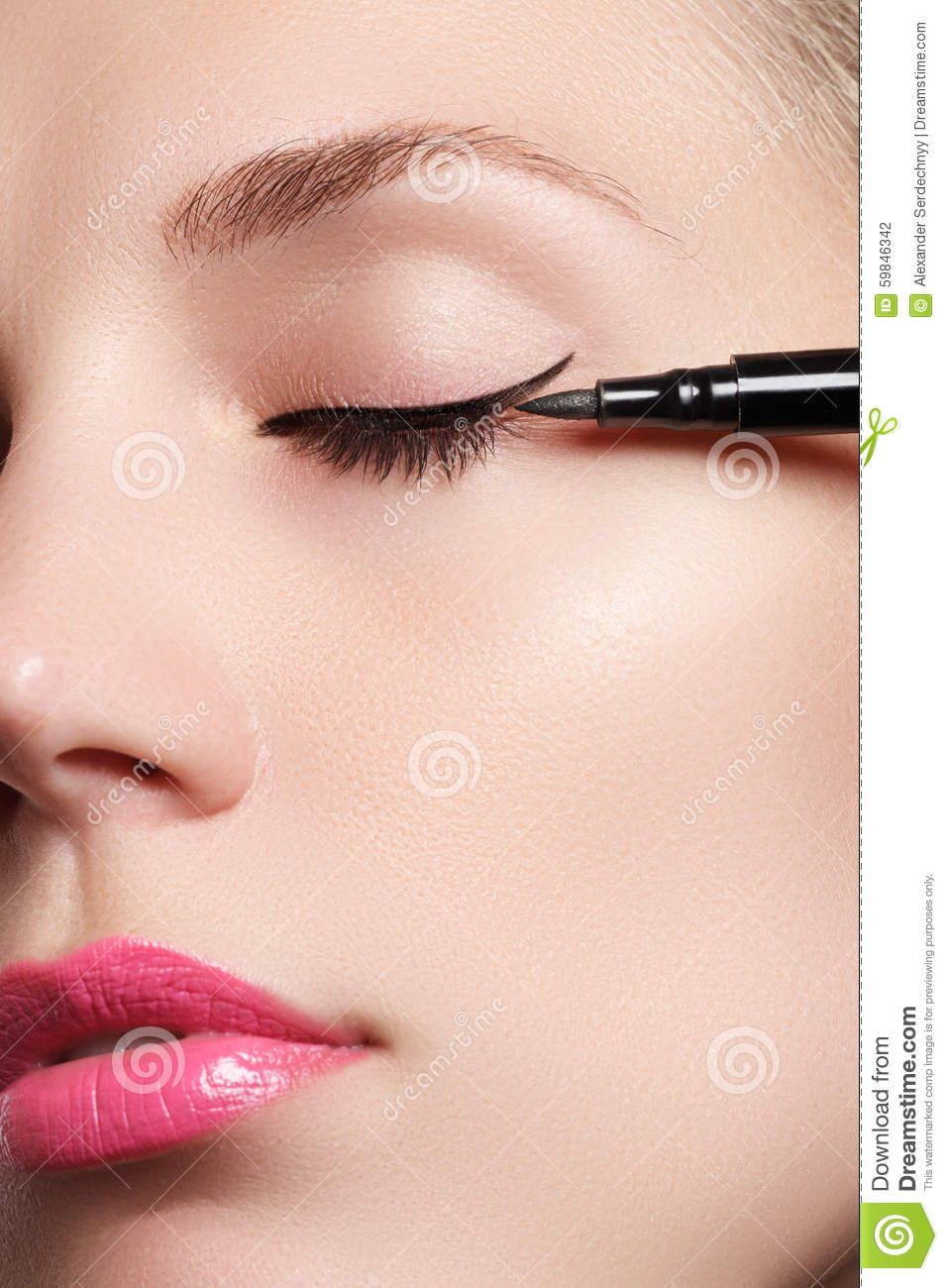 Beautiful woman with bright make up eye with black liner makeup. Fashion arrow shape. Chic evening make-up. Makeup beauty wit