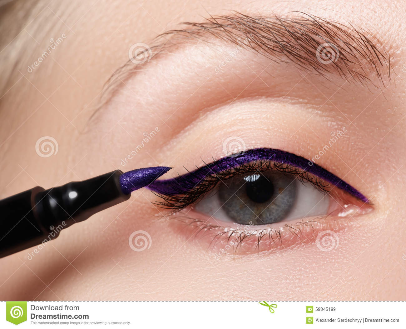 Beautiful woman with bright make up eye with blue liner makeup. Fashion arrow shape. Chic evening make-up. Makeup beauty wit