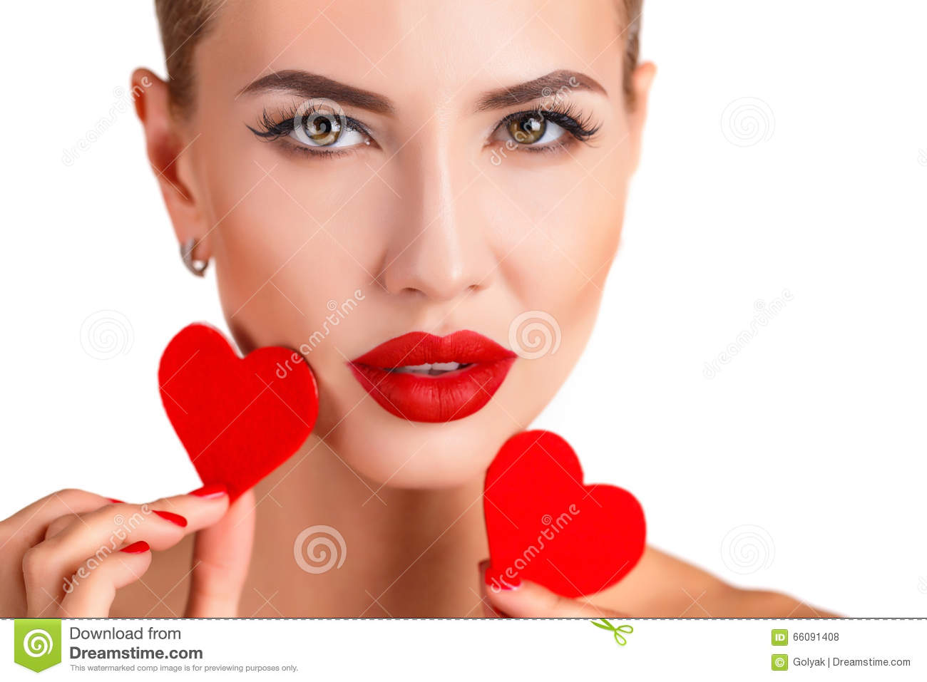 Beautiful woman with bright makeup and red heart