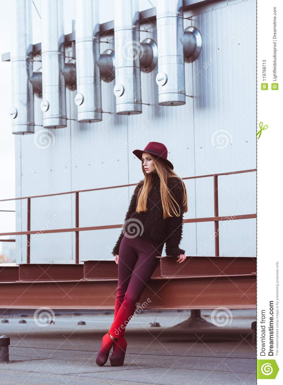 330c7e8069 Beautiful Woman In Burgundy Hat And Autumn Outfit Standing On A ...