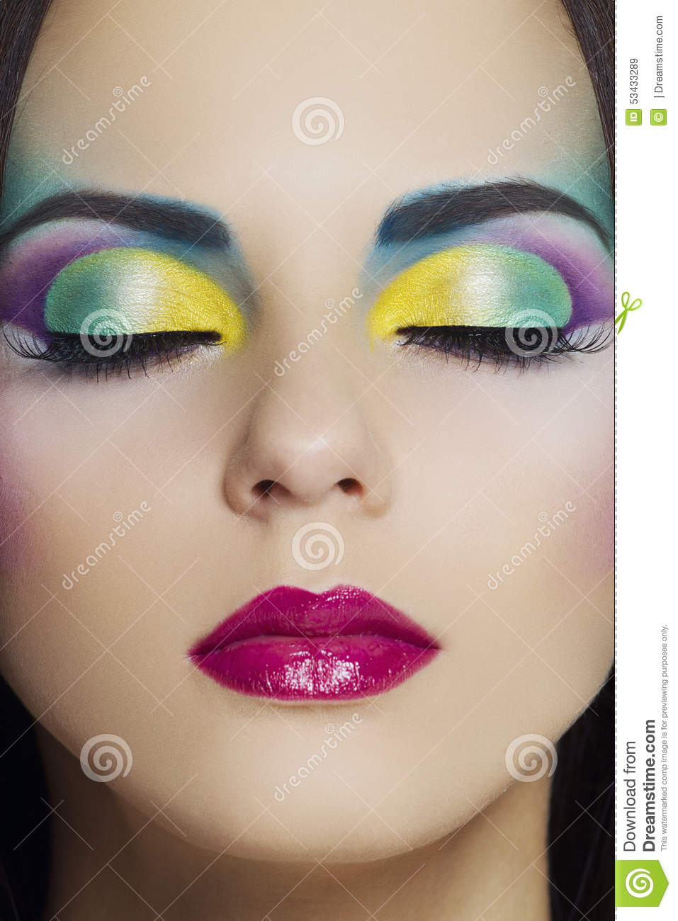 Beautiful woman with colourful makeup
