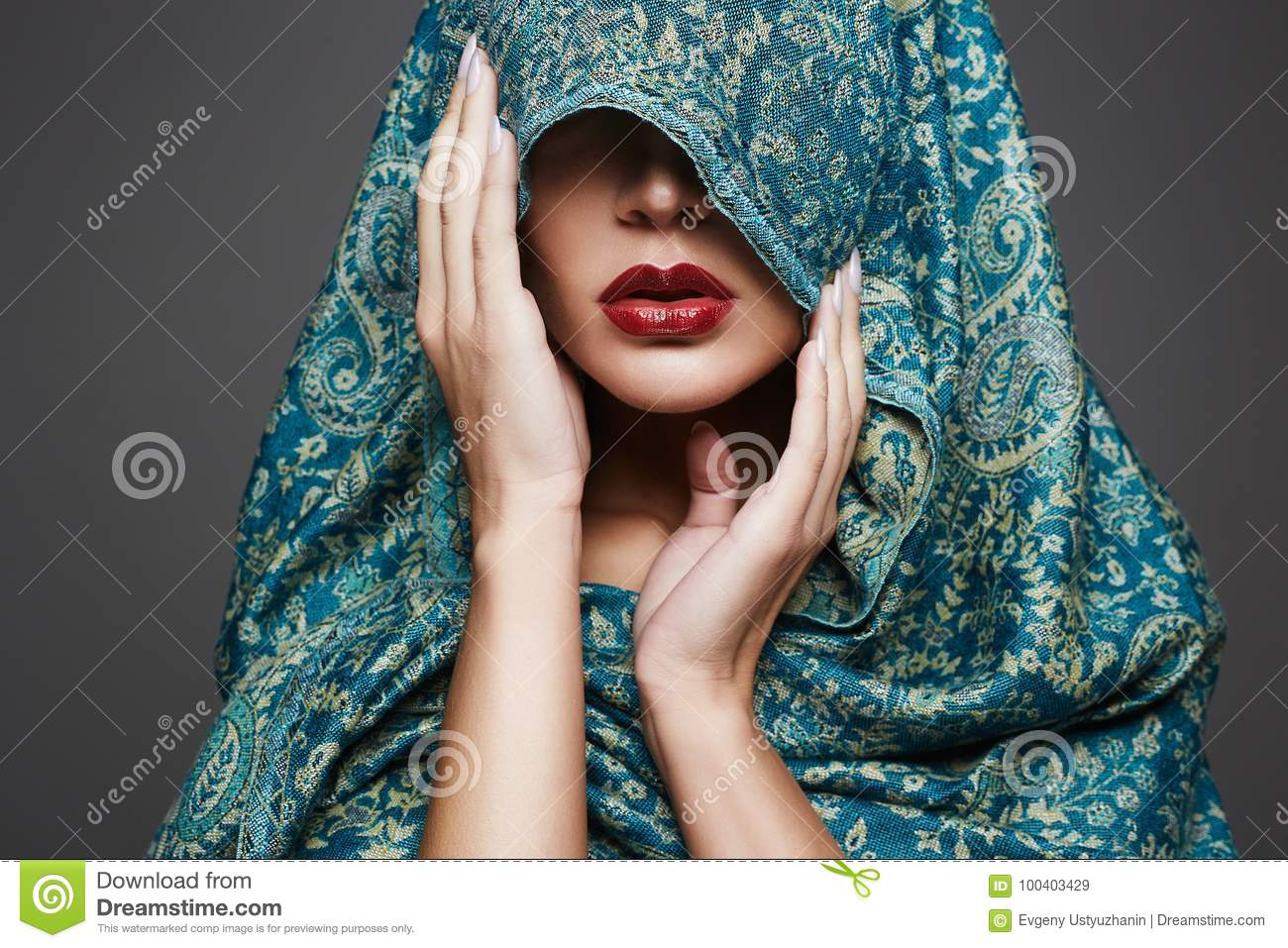 96061c53737 Beautiful woman covers her face with a colored cloth.red lips girl.fashion  islamic style woman